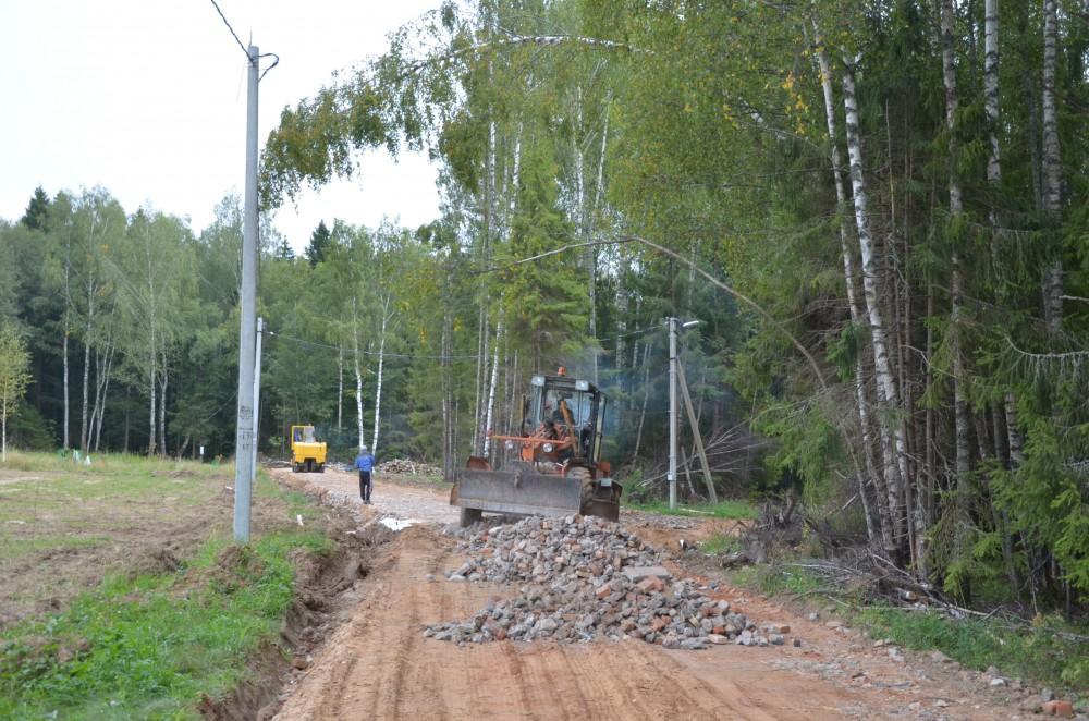 строительство дороги в дачном поселке Шараповское